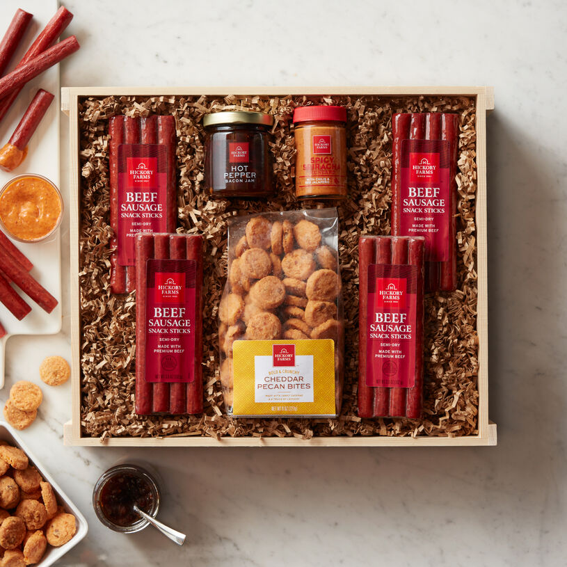 This crate has four packs of beef sticks, Sriracha Mustard, Hot Pepper Bacon Jam, Seasoned Mixed Nuts and Cranberry & Sesame Nut Mix.