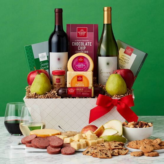 The Grand Sip and Snack Gift Basket includes wine, cheese, pears, apples, and crisps.