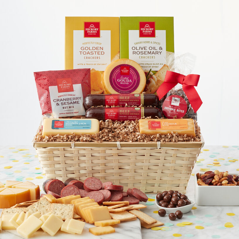 Celebration Gift Basket with beef summer sausage, various cheeses, crackers, nuts, and brownie bites.