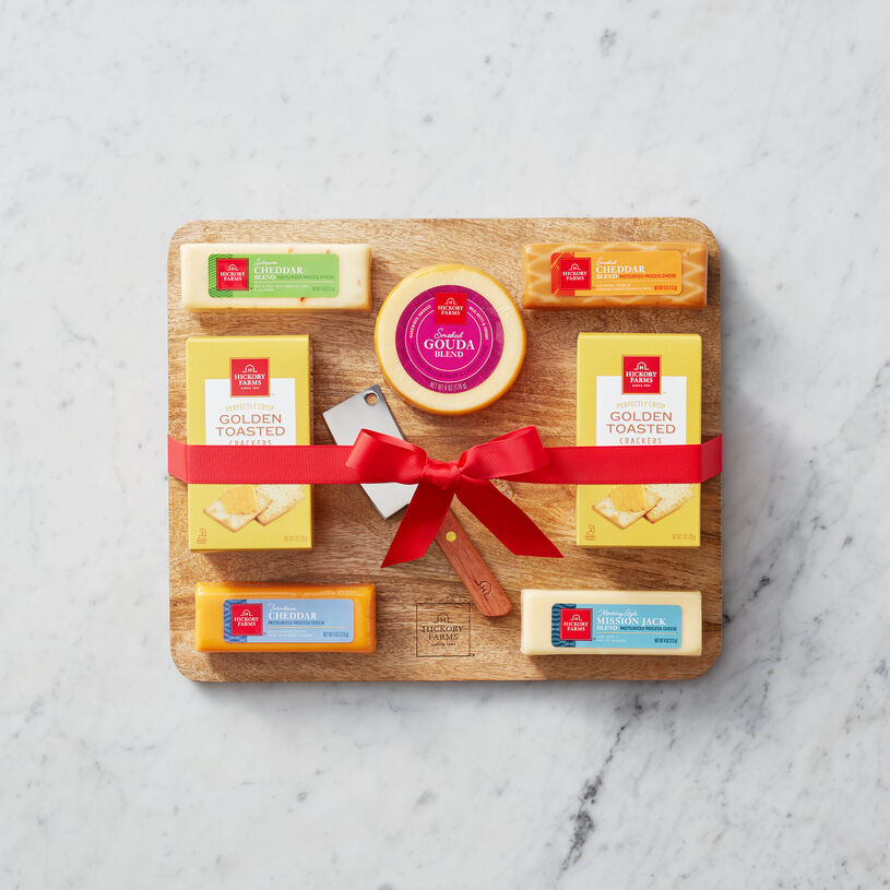 This gift set is filled with five of our gourmet cheeses, a Mango Wood Cheese Board, and Cheese Cleaver
