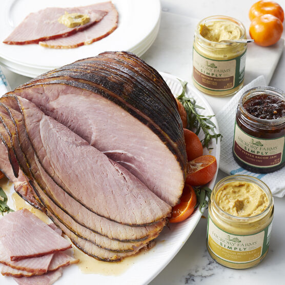 Simply Ham Collection includes a HoneyGold® Spiral Sliced Ham, Simply Spicy Brown Mustard, Hot Pepper Bacon Jam, Smoky Onion Mustard