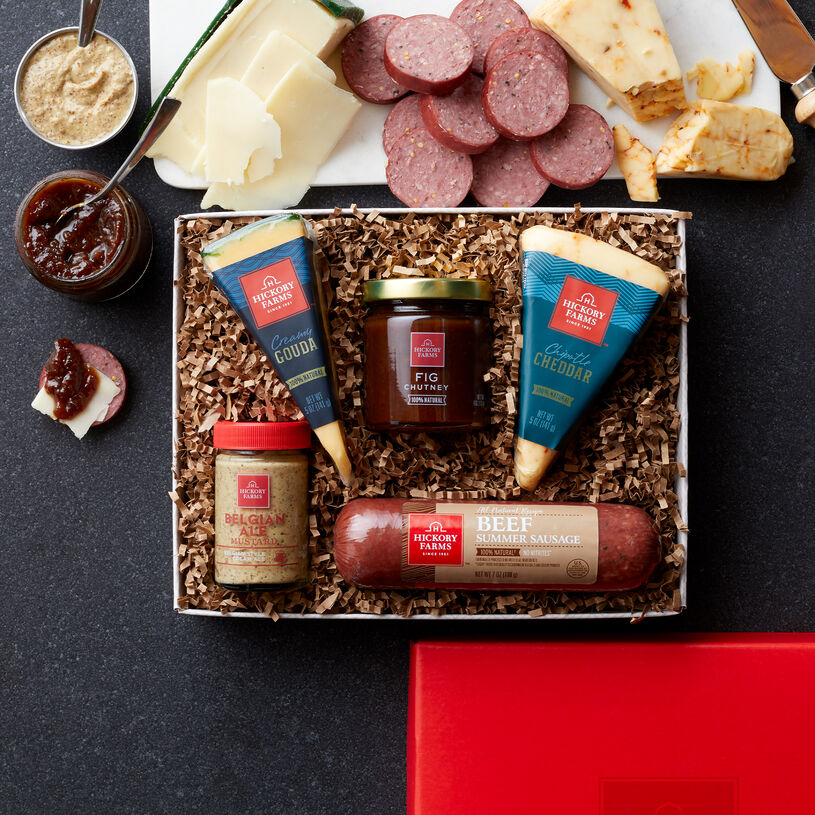 This Gift Box includes natural summer sausage, cheeses, mustard, and fig chutney