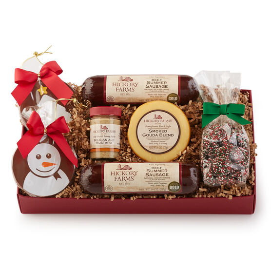 Signature Beef Summer Sausage, Smoked Gouda, Belgian Ale Mustard, and Golden Toasted Crackers are a savory addition to any gathering or a thoughtful gift. Colorful dark chocolate nonpareils and milk chocolate ornaments give a festive holiday touch.
