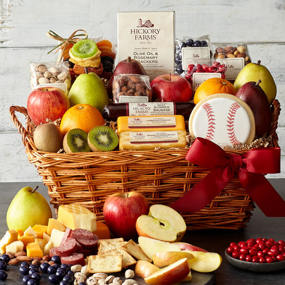 This gift basket is packed to the brim with fruit, summer sausage, cheese, crackers, mixed nuts, dried fruit, and a cookie.
