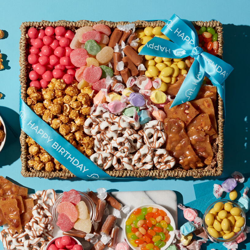 This beautiful basket is filled to the brim with unique snacks to delight a special someone's sweet tooth.