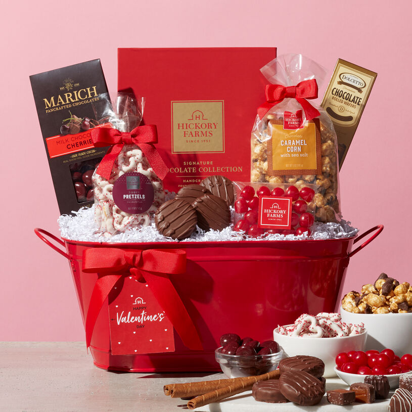 A festive red tin adorned with a special Valentine's Day gift tag, overflowing with sweets and candies is the perfect way to celebrate your special someone!