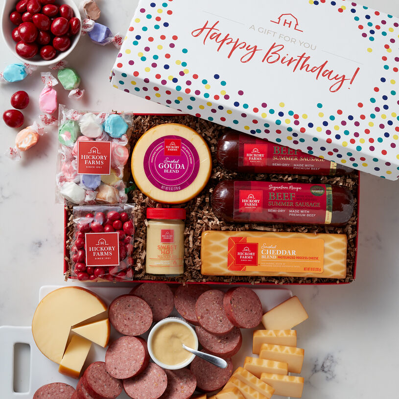 This festive birthday box is filled with our Signature Beef Summer Sausage, Smoked Gouda Blend, Smoked Cheddar Blend, Sweet Hot Mustard, plus saltwater taffy and cherry sours.