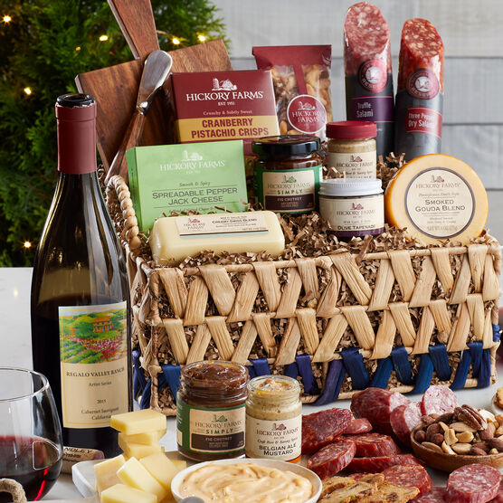 This basket is filled with savory salami, cheeses, mustard, chutney, tapenade, crackers, cheese board and spreader, and a bottle of Regalo Valley Ranch Cabernet Sauvignon