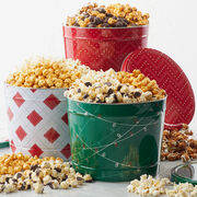 Premium popcorn packed in a holiday tin.
