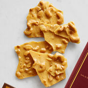 Our Cashew Brittle is cooled in thin layers to give it a crisp crunch.
