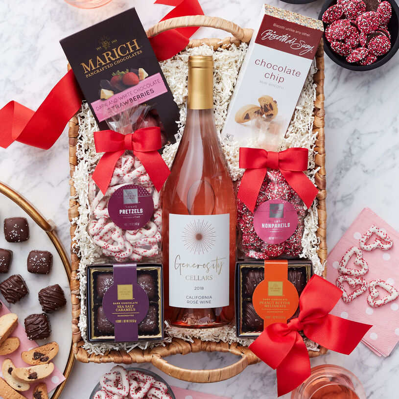 This gift basket is filled with decadent chocolates and adorable Valentine's Day treats and a bottle of Generosity Cellars California Rosé