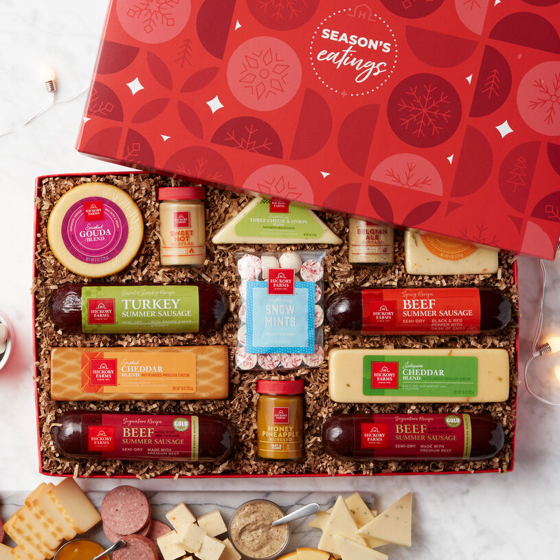 This gift includes our Signature, Spicy Beef, and Sweet & Smoky Turkey Summer Sausages. There's also five varieties of our favorite cheeses, and three kinds of mustards, and our famous Peppermint Snow Mints.