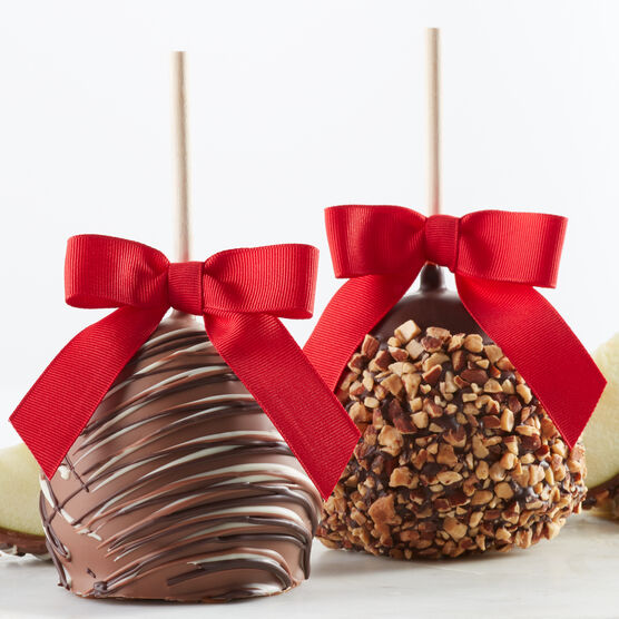 White & milk chocolate dipped caramel apples with chocolate drizzle