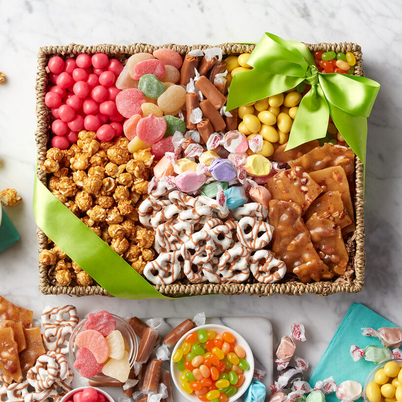 This sweets gift basket is filled to the brim with unique snacks to delight a special someone's sweet tooth.
