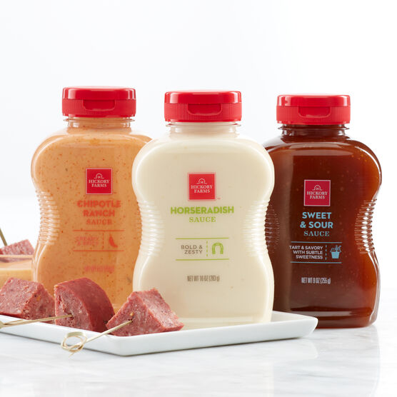 Condiment Flight includes horseradish sauce, chipotle ranch sauce, and sweet & sour sauce