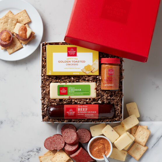 Spicy beef sampler includes spicy & savory beef summer sausage, jalapeno & cheddar cheese, crackers, and mustard