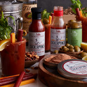 This crate features a mix for a Traditional or Spicy Bloody Mary, and salt for the rim of the glass. Serve alongside the meat & cheese sticks, Cajun Jalapeño Olives, and seasoned mixed nuts.