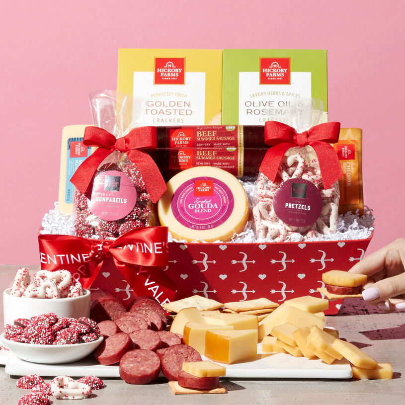 This Valentine's Day basket is filled with meat, cheese, crackers, heart pretzels, and chocolate nonpareils.