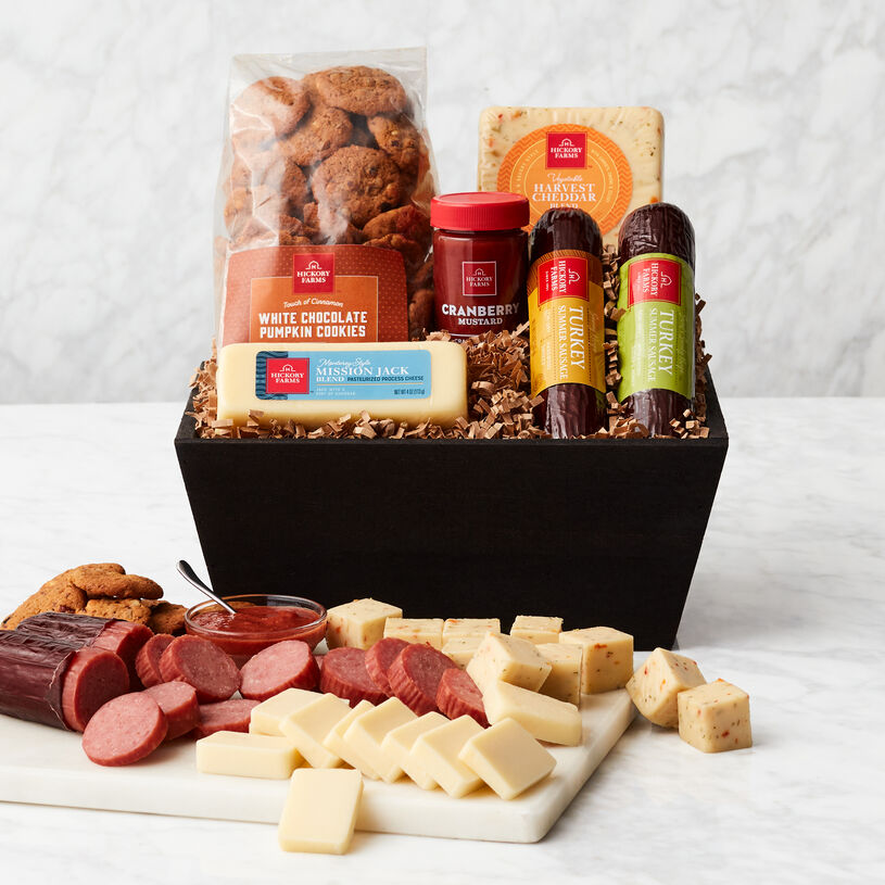 This gift basket is filled with harvest flavors like Turkey Summer Sausages, Harvest Cheddar Blend, Mission Jack Blend, Cranberry Mustard, and Pumpkin Cookies.