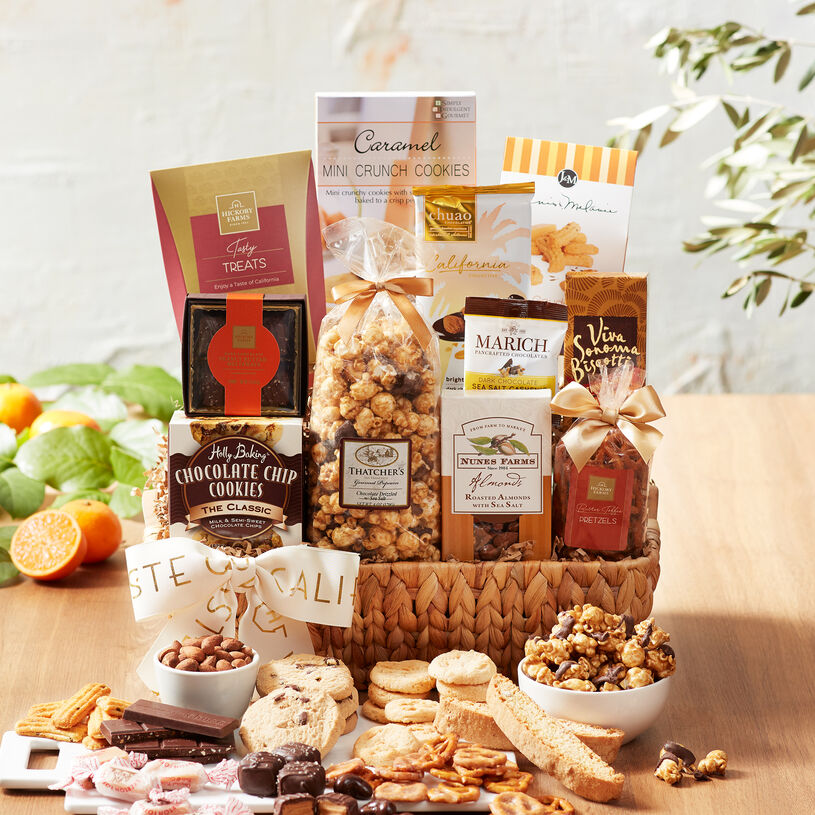 This basket is filled with sweet & salty California favorites like Butter Toffee Pretzels, Cashews, Cheese Straws, Roasted Almonds, and popcorn.