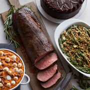 This comes with our famous Beef Tenderloin for Chateaubriand, Brown Sugar Sweet Potatoes, Green Bean Casserole, and an Intense Chocolate Fudge Layer Cake for dessert.