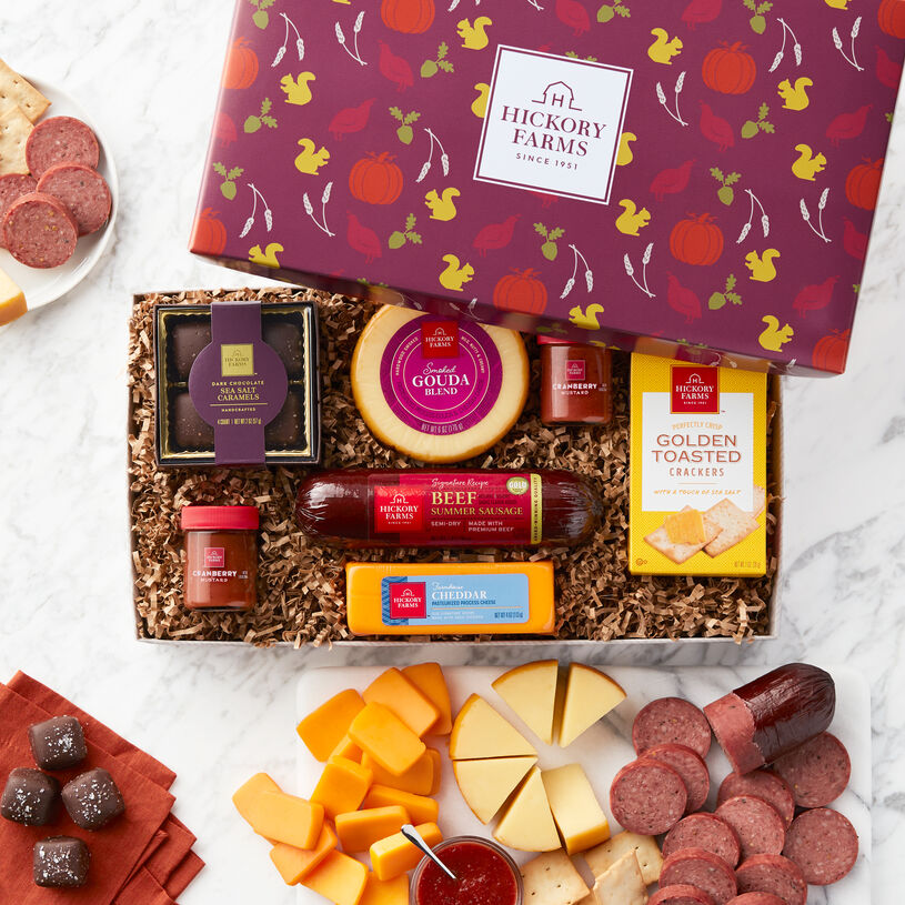 This fall gift box has Signature Beef Summer Sausage, Smoked Gouda, Farmhouse Cheddar, Cranberry Mustard, Golden Toasted Crackers, and Dark Chocolate Sea Salt Caramels.