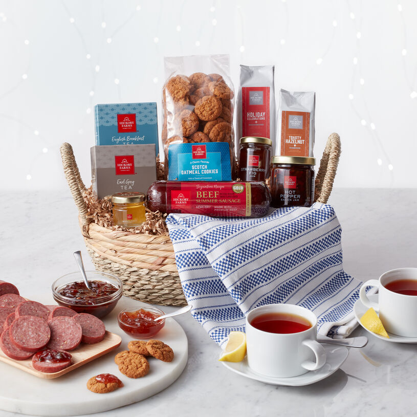 This gift features sweet and savory flavors like fruit preserves, Scotch Oatmeal Cookies, tea, honey, coffee, sausage, and cheese, all carefully packed in a chic reusable basket with a pretty tea towel.