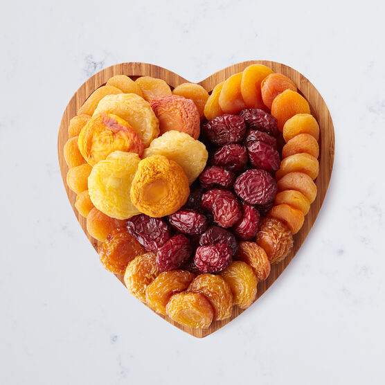 Fruit tray includes dried apples, pears, peaches, plums, and apricots