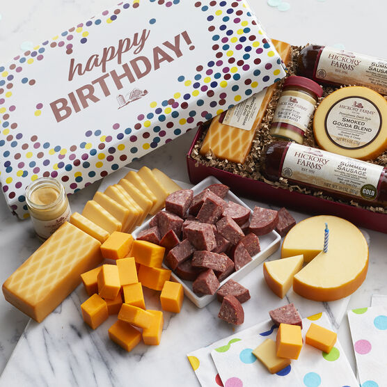 Festive confetti box filled with our Signature Beef Summer Sausage, Smoked Gouda, Smoked Cheddar, Sweet Hot Mustard, plus Salt Water Taffy and hard candies.