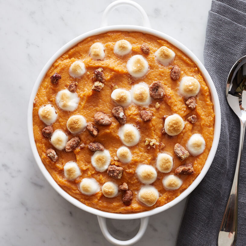 Cooked sweet potatoes are seasoned with brown sugar and cinnamon, then topped with praline pecans and marshmallows for a pretty (and delicious!) presentation.