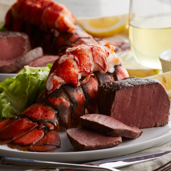 Perfectly tender Filet Mignon steaks are matched with our sweet, succulent lobster tails.