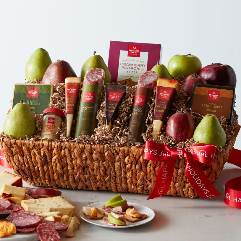 This holiday basket includes dry salami, all natural cheeses, mustard, crackers, and pears.