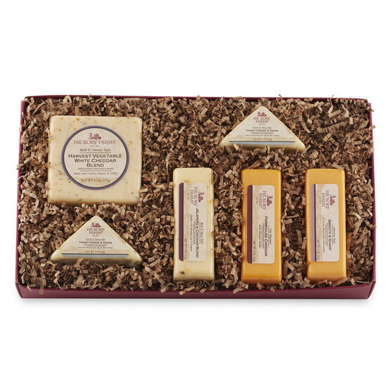 Cheese tasting collection includes Farmhouse Cheddar, Smooth & Sharp, Harvest Vegetable Cheddar, and Three Cheese & Onion