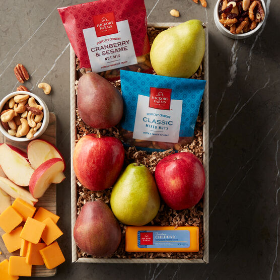 Fruit Snack Assortment includes, cheese, pistachios, mixed nuts, apples, and pears