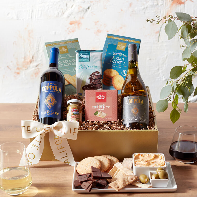 This wine gift box includes two wines from Francis Ford Coppola, spreadable cheese, sourdough crackers, olives, sugar cookies, and a chocolate bar.