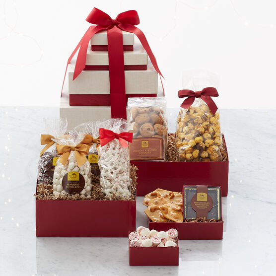 This gift features four boxes packed with chocolate, sweets, treats, and candies.