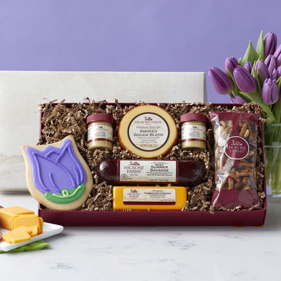 Spring Cravings Assortment includes summer sausage, cheese, nut mix, mustard, and a tulip cookie