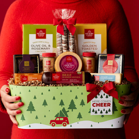 Here Comes Cheer Holiday Gift Basket Held by Person