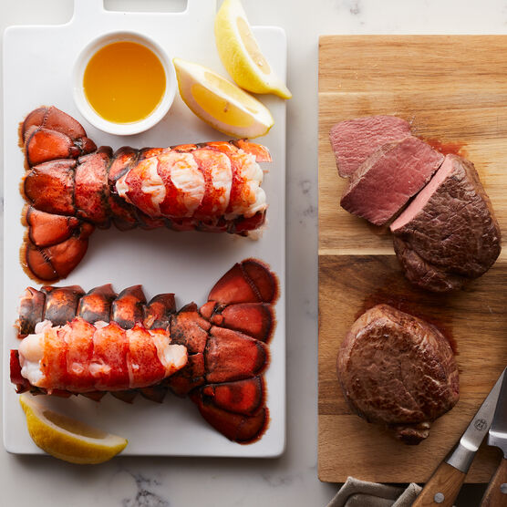 Alternate View of Perfectly tender Filet Mignon steaks are matched with our sweet, succulent lobster tails. Our Surf & Turf is a delicious choice for a special meal.