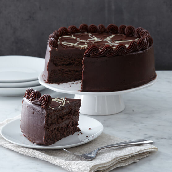 The Premium Holiday Dinner includes an Intense Chocolate Fudge Layer Cake for dessert