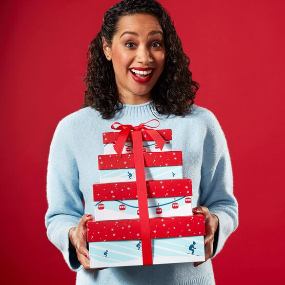 Snow Day Sweets Gift Tower Held By Woman