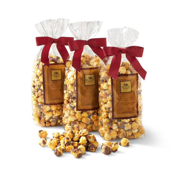 peanut brittle popcorn with chocolate drizzle