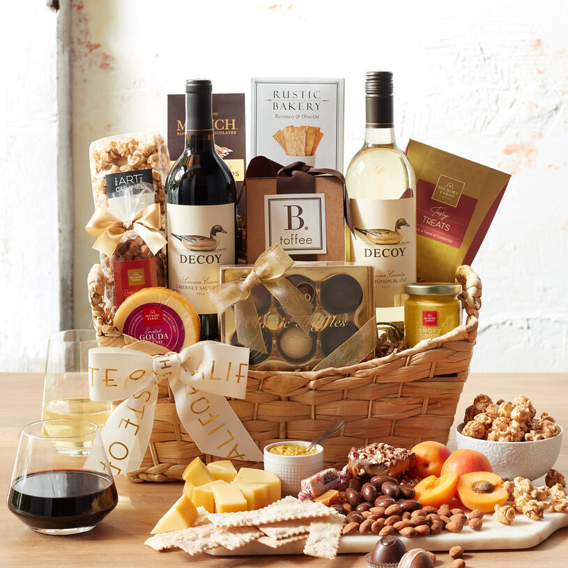 This wine gift basket features two bottles of Decoy wine from renown Duckhorn Vineyards paired with sweet and savory snacks.