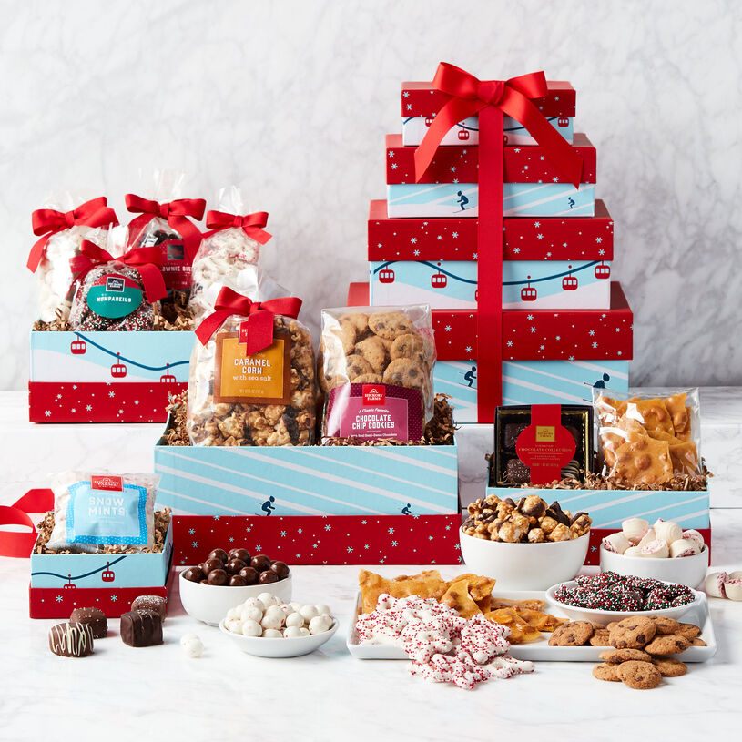 This winter gift tower features four specially-designed boxes filled with deliciously sweets!