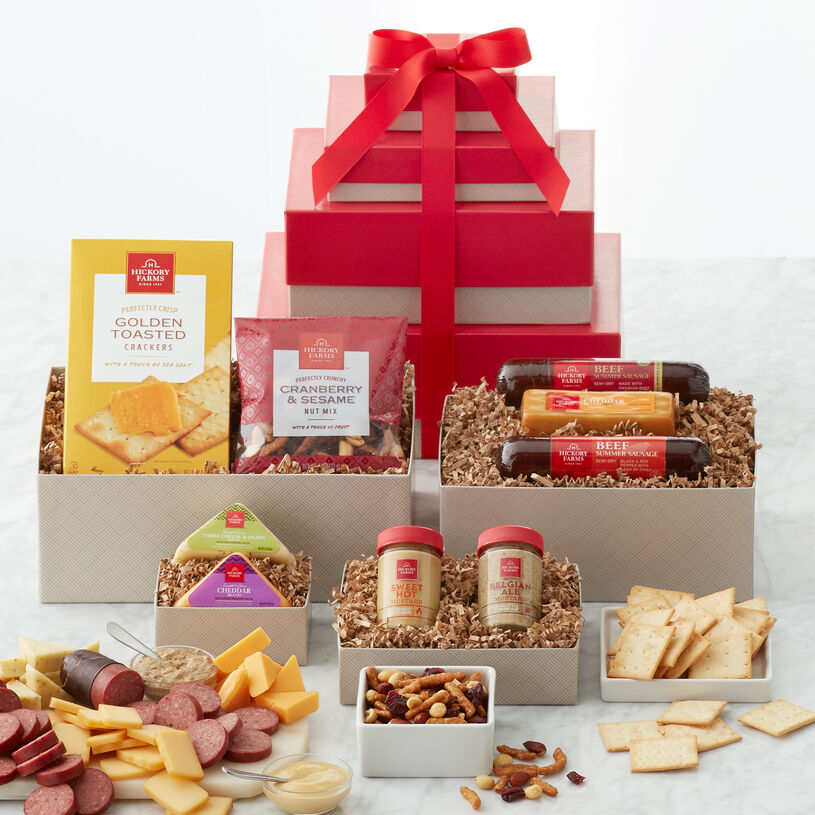 This impressive gift tower includes a variety of sausage, cheese, mustard, and nuts.