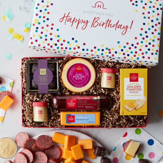 Best Birthday Wishes Gift Box includes beef summer sausage, gouda and cheddar cheese, sweet hot mustard, golden crackers, and chocolates