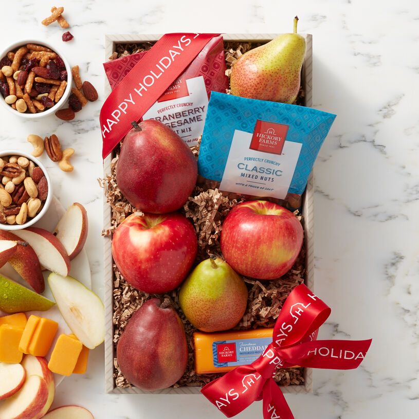 Included are Crown Comice Pears, an assortment apples, smooth and creamy Farmhouse Cheddar, Cranberry & Sesame Nut Mix, and Classic Nut Mix.