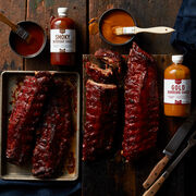 This set comes with four racks of our Premium Pork Ribs that arrive plain so he can prepare them his way. South Carolina mustard-style Gold Barbeque Sauce and Memphis-style sweet Smoky Barbeque Sauce