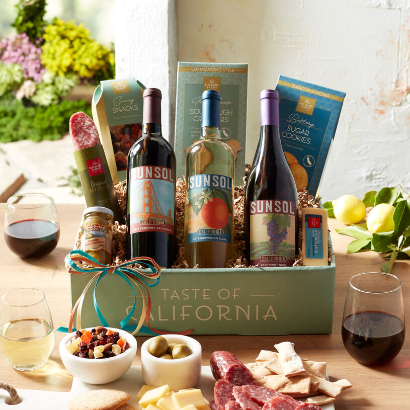 Send a taste of the West Coast with this wine gift! It includes savory Hickory Farms favorites and delicious California snacks.