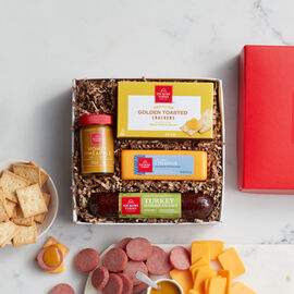 Hickory Farms Sweet & Smoky Turkey Sampler includes turkey summer sausage, mustard, cheese, and crackers